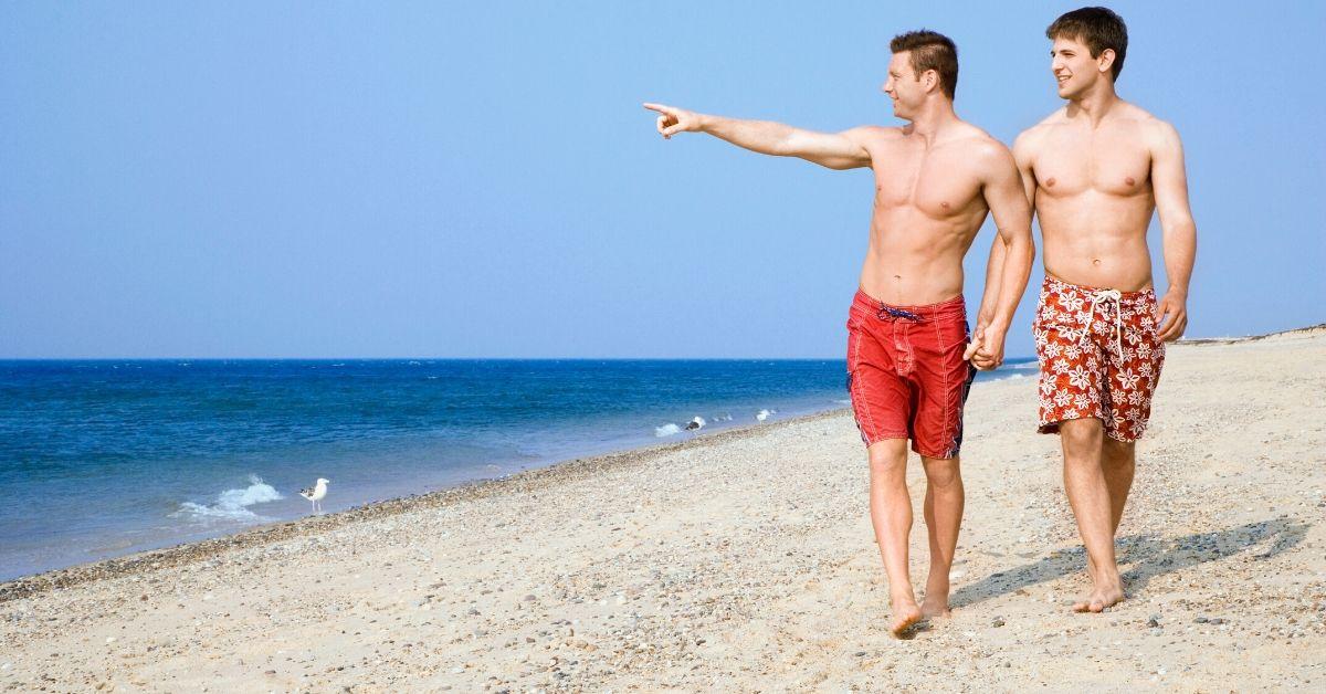 Gay man sex on beach